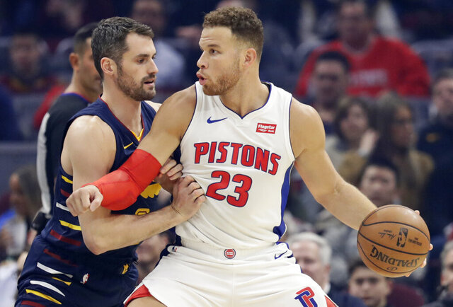 Detroit Pistons' Blake Griffin, right, drives past Cleveland Cavaliers' Kevin Love in the first half of an NBA basketball game, Tuesday, Dec. 3, 2019, in Cleveland. (AP Photo/Tony Dejak)