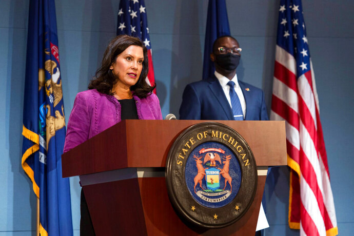 In a photo provided by the Michigan Office of the Governor, Gov. Gretchen Whitmer addresses the state during a speech in Lansing, Mich., Wednesday, Aug. 5, 2020. The governor announced additional steps to combat racism, declaring it a public health crisis and ordering state employees to complete implicit bias training as the state confronts what she called systemic inequities highlighted by the coronavirus pandemic. She also created an advisory council of Black leaders. (Michigan Office of the Governor via AP)
