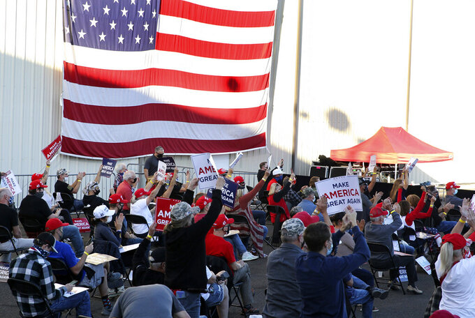 Supporters respond to a speech by Vice President Mike Pence at a campaign rally at Reno-Tahoe International Airport in Reno, Nev., Thursday, Oct. 29, 2020. (AP Photo/Lance Iversen)