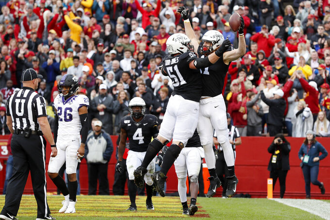 Iowa State tight end Chase Allen, right, celebrates with teammate Julian Good-Jones (51) after catching one-yard touchdown pass during the first half of an NCAA college football game against TCU, Saturday, Oct. 5, 2019, in Ames, Iowa. (AP Photo/Charlie Neibergall)