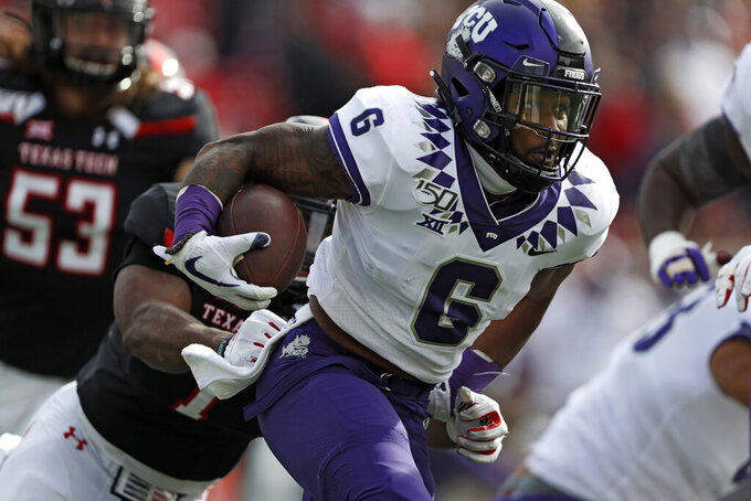 TCU's Darius Anderson (6) breaks a tackle while running with the ball during the first half of an NCAA college football game against Texas Tech, Saturday, Nov. 16, 2019, in Lubbock, Texas. (Brad Tollefson/Lubbock Avalanche-Journal via AP)
