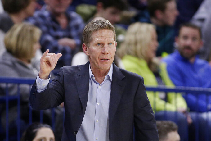 Gonzaga coach Mark Few signals to his team during the second half of an NCAA college basketball game against Saint Mary's in Spokane, Wash., Saturday, Feb. 9, 2019. Gonzaga won 94-46. (AP Photo/Young Kwak)