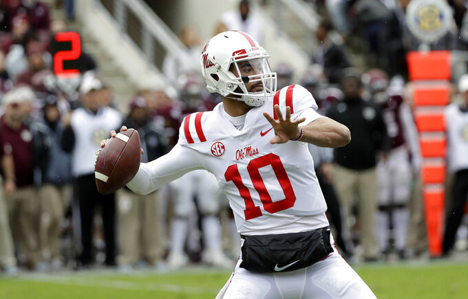 Mississippi Rebels quarterback Jordan Ta'amu (10) throws a pass against Texas A&M during the first half of an NCAA college football game Saturday, Nov. 10, 2018, in College Station, Texas. (AP Photo/David J. Phillip)