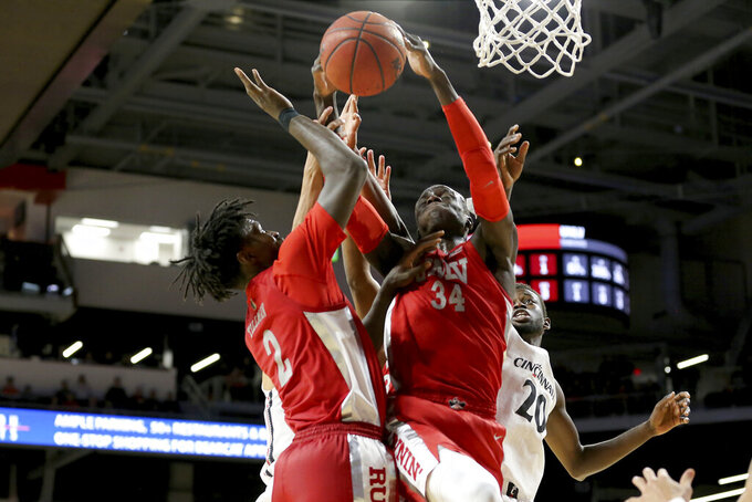 UNLV forward Cheikh Mbacke Diong (34) pulls down a rebound next to Cincinnati forward Mamoudou Diarra (20) during the first half of an NCAA college basketball game Saturday, Nov. 30, 2019, in Cincinnati. (Kareem Elgazzar/The Cincinnati Enquirer via AP)