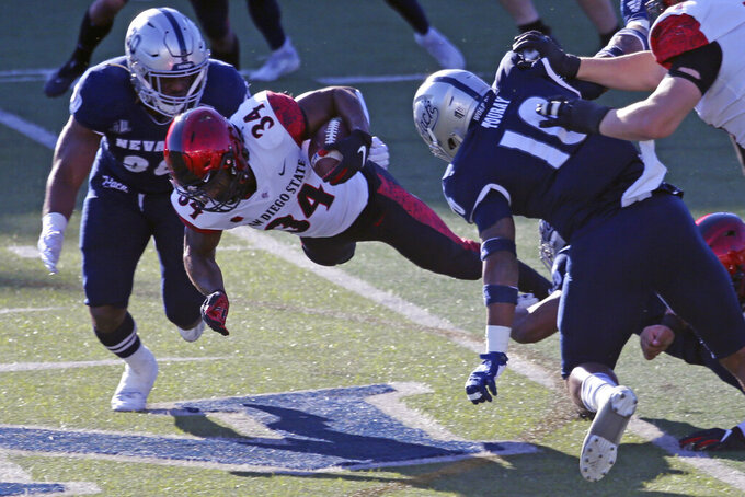 San Diego State running back Greg Bell runs for a first down against Nevada during the first half of an NCAA college football game Saturday, Nov. 21, 2020, in Reno, Nev. (AP Photo/Lance Iversen)