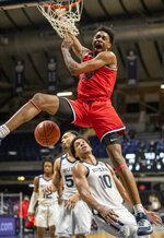 St. John's forward Isaih Moore (13) throws down a dunk, during an NCAA college basketball game against Butler, Tuesday, Feb. 9, 2021, in Indianapolis. (Robert Scheer/The Indianapolis Star via AP)