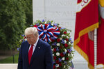President Donald Trump turns after placing a wreath at the Tomb of the Unknown Soldier in Arlington National Cemetery, in honor of Memorial Day, Monday, May 25, 2020, in Arlington, Va. (AP Photo/Alex Brandon)