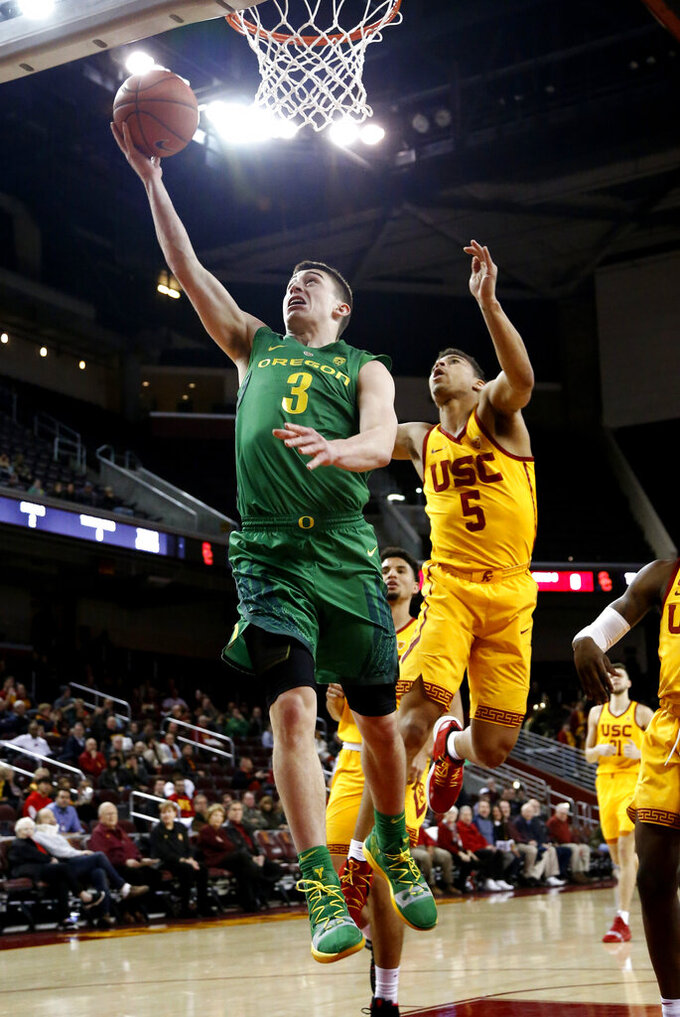 Oregon's Payton Pritchard, left, goes to basket while defended by Southern California's Derryck Thornton during the first half of an NCAA college basketball game Thursday, Feb. 21, 2019, in Los Angeles. (AP Photo/Ringo H.W. Chiu)