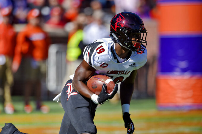 Louisville's Hassan Hall runs back a kickoff during the first half of an NCAA college football game against Clemson, Saturday, Nov. 3, 2018, in Clemson, S.C. (AP Photo/Richard Shiro)