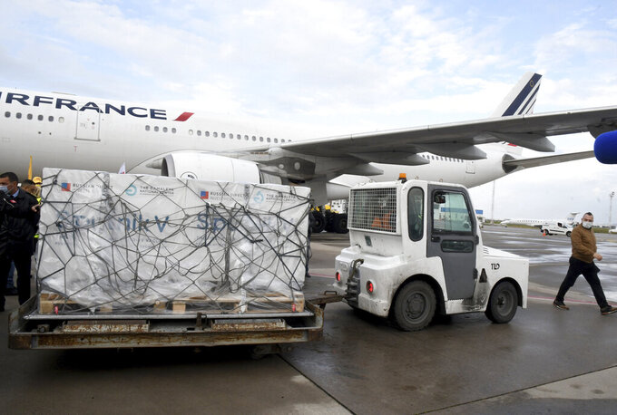 Boxes loaded with the Russian Sputnik V COVID-19 vaccine arrive at Tunis airport, Tuesday, March 9, 2021. Tunisia is also awaiting the arrival of the first lot of the Chinese vaccine Sinovac as well as the Pfizer and Astrozeneca vaccines (AP Photo/Hassene Dridi)