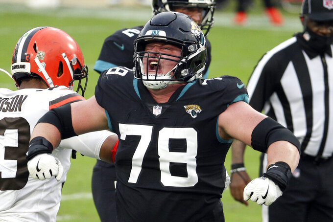 Jacksonville Jaguars offensive tackle Ben Bartch (78) celebrates as his team scored a touchdown against the Cleveland Browns during the second half of an NFL football game, Sunday, Nov. 29, 2020, in Jacksonville, Fla. (AP Photo/Stephen B. Morton)