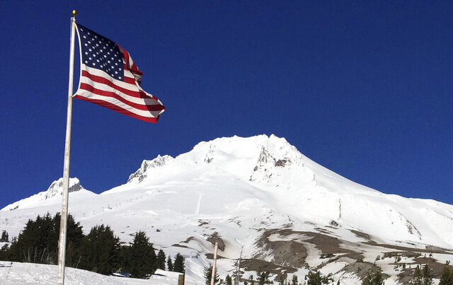 FILE - In this Feb. 13, 2018 file photo, Oregon's Mount Hood is seen from Timberline Lodge on the south side of the mountain. Authorities say a rescue mission has become a recovery mission on Mount Hood after a climber reported finding a fallen person Tuesday, Feb. 25, 2020 at 9,400 feet.  (AP Photo/Gillian Flaccus, File)