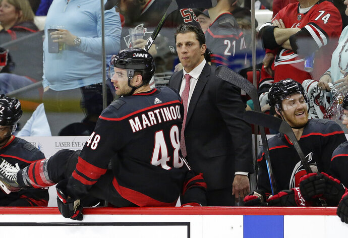 Carolina Hurricanes coach Rod Brind'Amour watches as Hurricanes' Jordan Martinook (48) takes the ice against the Washington Capitals during the first period of Game 3 of an NHL hockey first-round playoff series in Raleigh, N.C., Monday, April 15, 2019. (AP Photo/Gerry Broome)