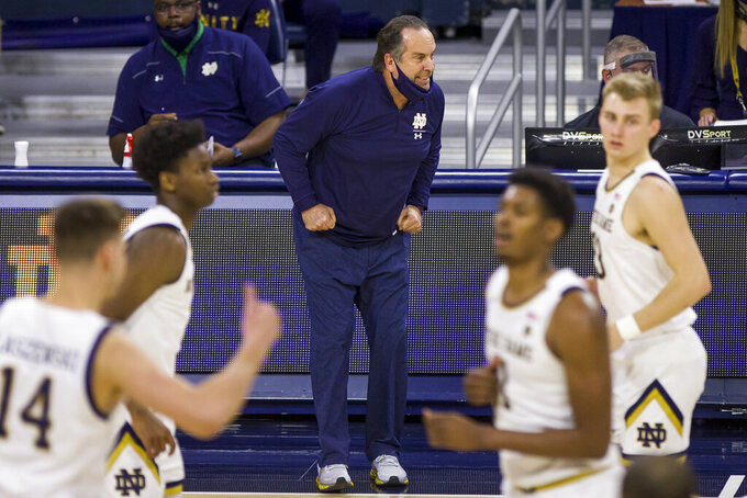 Notre Dame head coach Mike Brey, center, reacts to action on the court during the first half of an NCAA college basketball game against Boston College, Saturday, Jan. 16, 2021, in South Bend, Ind. (AP Photo/Robert Franklin)