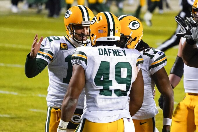 Green Bay Packers' Dominique Dafney is congratulated by quarterback Aaron Rodgers after catching a touchdown pass during the first half of an NFL football game against the Chicago Bears Sunday, Jan. 3, 2021, in Chicago. (AP Photo/Nam Y. Huh)
