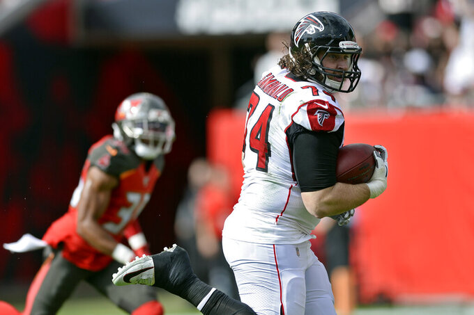 Atlanta Falcons offensive tackle Ty Sambrailo (74) scores against the Tampa Bay Buccaneers on a 35-yard touchdown reception during the first half of an NFL football game Sunday, Dec. 29, 2019, in Tampa, Fla. (AP Photo/Jason Behnken)