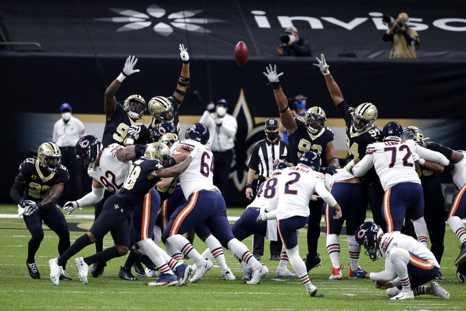 Chicago Bears kicker Cairo Santos (2) kicks a field goal in the first half of an NFL wild-card playoff football game against the New Orleans Saints in New Orleans, Sunday, Jan. 10, 2021. (AP Photo/Butch Dill)
