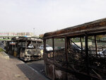 This photo released by the Iranian Students' News Agency, ISNA, shows scorched public buses that remained on the street after protests that followed authorities' decision to raise gasoline prices, in Tehran, Iran, Sunday, Nov. 17, 2019.  Ayatollah Ali Khamenei, Iran's supreme leader, on Sunday backed the government's decision to raise gasoline prices and called angry protesters who have been setting fire to public property over the hike