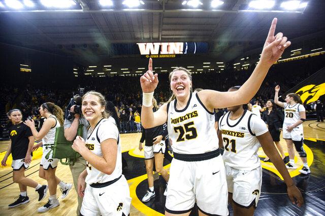 Iowa guard Kathleen Doyle, left, and center Monika Czinano (25) celebrate after the team's NCAA college basketball game againstNebraska, Thursday, Feb. 6, 2020, in Iowa City, Iowa. (Joseph Cress/Iowa City Press-Citizen via AP)