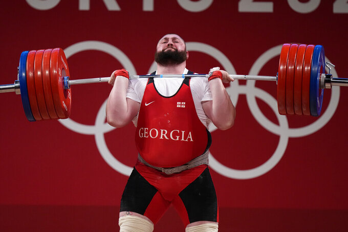 Talakhadze breaks weightlifting records, Syria wins medal