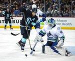 Seattle Kraken's forward Jaden Schwartz (17) tries to get a shot past Vancouver Canucks' goalie Spencer Martin in the third period of an NHL preseason hockey game Sunday, Sept. 26, 2021, in Spokane, Wash. (Dean Rutz/The Seattle Times via AP)