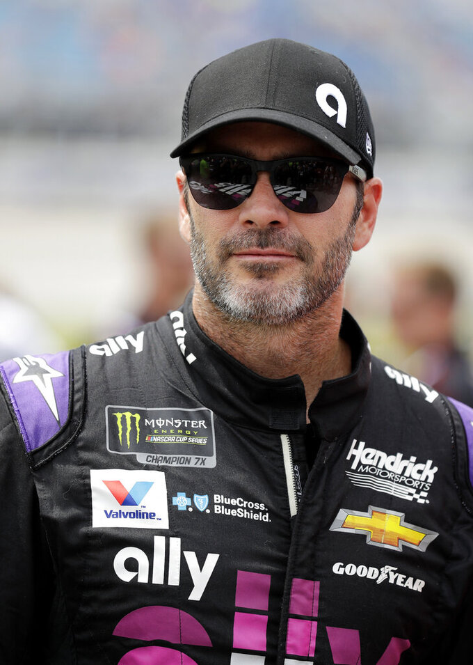 Jimmie Johnson waits for a NASCAR Cup Series auto race at Chicagoland Speedway in Joliet, Ill., Sunday, June 30, 2019. (AP Photo/Nam Y. Huh)