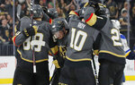 Vegas Golden Knights celebrate after defeating the St. Louis Blues during overtime of an NHL hockey game Saturday, Jan. 4, 2020, in Las Vegas. (AP Photo/John Locher)