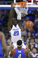 Creighton's Damien Jefferson (23) dunks as DePaul's Paul Reed (4) watches, during the first half of an NCAA college basketball game in Omaha, Neb., Saturday, Feb. 15, 2020. (AP Photo/Nati Harnik)