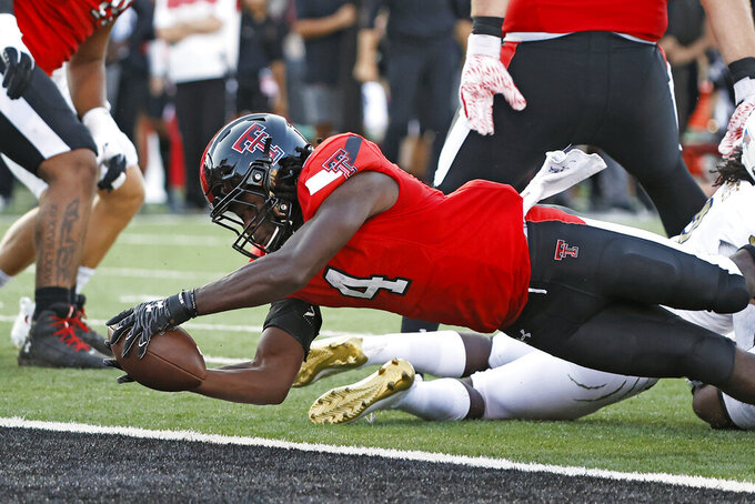 Texas Tech's SaRodorick Thompson (4) scores a touchdown during the first half of an NCAA college football game against Florida International, Saturday, Sept. 18, 2021, in Lubbock, Texas. (AP Photo/Brad Tollefson)