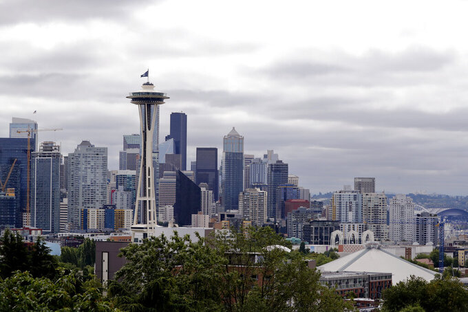 """FILE - This July 23, 2020, file photo shows the view of the Space Needle, in Seattle. Record-high heat is forecast in the Pacific Northwest this weekend, raising concerns about wildfires and the health of people in a region where many don't have air conditioning. The National Weather Service has issued an Excessive Heat Watch and predicted """"dangerously hot"""" conditions Friday, June 25, 2021, through at least Tuesday. (AP Photo/Elaine Thompson, File)"""
