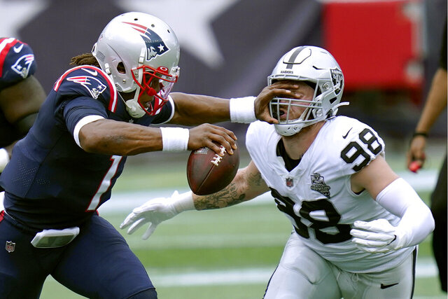 Las Vegas Raiders defensive end Maxx Crosby (98) gets a poke in the eye as he closes in to sack New England Patriots quarterback Cam Newton in the first half of an NFL football game, Sunday, Sept. 27, 2020, in Foxborough, Mass. (AP Photo/Charles Krupa)