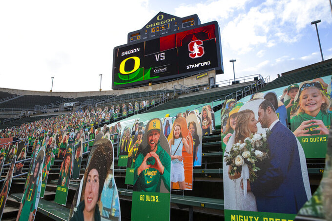 Cutouts of Oregon Ducks fans take the place of real ones at Autzen Stadium as Stanford and Oregon get ready for their first NCAA college football game of the season Saturday, Nov. 7, 2020, in Eugene, Ore. (AP Photo/Chris Pietsch)