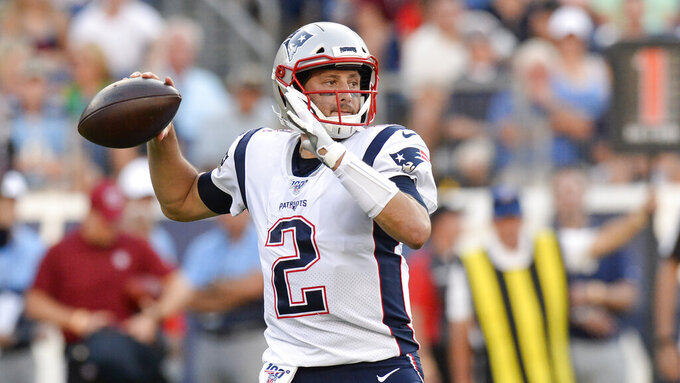 FILE - In this Aug. 17, 2019, file photo, New England Patriots quarterback Brian Hoyer passes against the Tennessee Titans in the first half of a preseason NFL football game in Nashville, Tenn. Hoyer is returning to the Patriots for a third time.  The veteran quarterback has agreed to a one-year deal worth $1.05 million.  AP Photo/Mark Zaleski, File)