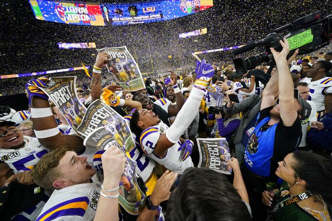 FILE - In this Jan. 13, 2020, file photo, LSU celebrates after their win against Clemson in a NCAA College Football Playoff national championship game in New Orleans. The photo was part of a series of images by photographer David J. Phillip which won the Thomas V. diLustro best portfolio award for 2020 given out by the Associated Press Sports Editors during their annual winter meeting. (AP Photo/David J. Phillip, File)