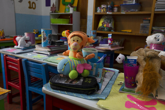 Empty desks stand in a classroom of the Casa del Colibri school in Mexico City, Wednesday, July 15, 2020. The school has been teaching its students remotely via the internet due to the COVID-19 pandemic. (AP Photo/Marco Ugarte)