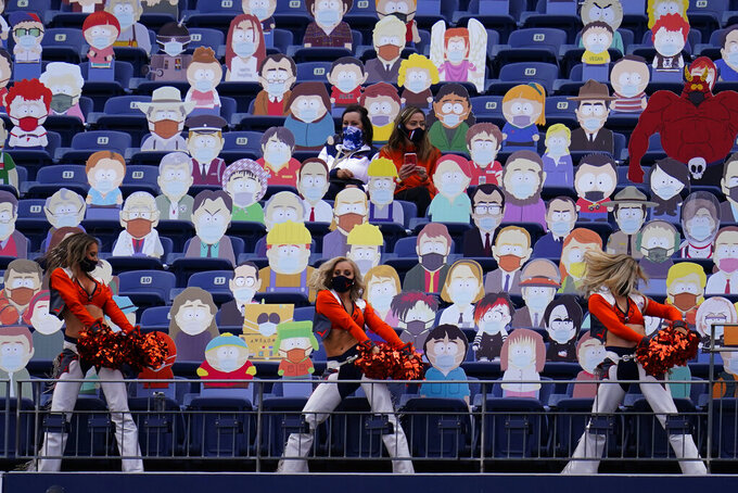 Denver Broncos cheerleaders perform as two fans sit among cardboard characters from the show South Park during the first half of an NFL football game against the Tampa Bay Buccaneers, Sunday, Sept. 27, 2020, in Denver. (AP Photo/Jack Dempsey)
