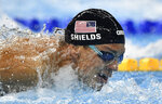 FILE - In this Aug. 11, 2016, file photo, United States' Tom Shields competes in a men's 100-meter butterfly semifinal during the swimming competitions at the 2016 Summer Olympics, in Rio de Janeiro, Brazil. A debate is fomenting between former gold medalist Maya DiRado and some American swimmers over Andrew's decision not to be vaccinated against the COVID-19 virus on the eve of competition at the Tokyo Olympics. (AP Photo/Martin Meissner, File)