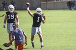 Texas quarterback Hudson Card throws a pass during an NCAA college football practice Saturday, Aug. 7, 2021, in Austin, Texas. (Aaron E. Martinez /Austin American-Statesman via AP)