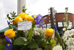 Flowers are seen on a memorial outside the Davis Police Department for slain Davis Police Officer Natalie Corona, Friday, Jan. 11, 2019, in Davis, Calif. Corona, 22, who had been on the job only a few weeks was shot and killed, Thursday, by a suspect who opened fire as she was investigating a three-car crash. The suspect was later found dead from a self-inflicted gunshot, following a standoff with officers. (AP Photo/Rich Pedroncelli)