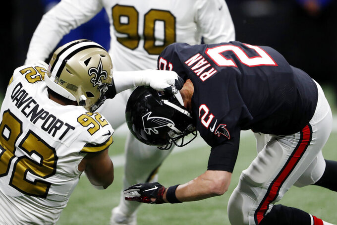 New Orleans Saints defensive end Marcus Davenport (92) sacks Atlanta Falcons quarterback Matt Ryan (2) during the first half of an NFL football game, Thursday, Nov. 28, 2019, in Atlanta. (AP Photo/John Bazemore)