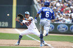 FILE - In this June 16, 2019, file photo, Minnesota Twins' Ehire Adrianza, left, catches the ball at first to get out Kansas City Royals' Billy Hamilton during the fifth inning of a baseball game in Minneapolis. The Twins have agreed with Adrianza and new reliever Matt Wisler on one-year contracts to avoid salary arbitration. They also decided not to tender deals to first baseman C.J. Cron and relief pitcher Trevor Hildenberger, on deadline day for major league teams to offer contracts to unsigned players. (AP Photo/Stacy Bengs, File)