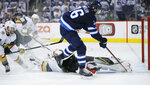 Winnipeg Jets' Blake Wheeler (26) beats Vegas Golden Knights goaltender Marc-Andre Fleury (29) but misses the open net during the second period of Game 1 of the NHL hockey playoffs Western Conference final, Saturday, May 12, 2108, in Winnipeg, Manitoba. (John Woods/The Canadian Press via AP)