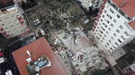 This frame made from video shows the site where a seven-story building collapsed, in Istanbul, Wednesday, Feb. 6, 2019. A seven-story building collapsed in Istanbul on Wednesday, killing at least one person and trapping several others inside the rubble, Turkish media reports said. (DHA via AP)