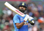 India's captain Virat Kohli reacts as he leaves the field after being dismissed during the Cricket World Cup match between India and Pakistan at Old Trafford in Manchester, England, Sunday, June 16, 2019. (AP Photo/Aijaz Rahi)
