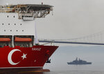 FILE-In this Thursday, June 20, 2019 file photo, Turkey's 230-meter (750-foot) drillship 'Yavuz' escorted by a Turkish Navy vessel, crosses the Marmara Sea on its way to the Mediterranean, from the port of Dilovasi, outside Istanbul. The Turkish Foreign Ministry said Wednesday, July 10, 2019 it rejects the European Union's statements condemning its efforts to drill for gas in waters off the coast of Cyprus and says the EU cannot be considered an impartial mediator for the divided island. Cyprus says Turkey is encroaching in waters where the country has exclusive economic rights while the European Union warned Turkey of sanctions. (AP Photo/Lefteris Pitarakis, File)