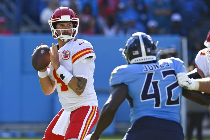 Kansas City Chiefs quarterback Chad Henne (4) passes as he is pressured by Tennessee Titans linebacker Joe Jones (42) in the second half of an NFL football game Sunday, Oct. 24, 2021, in Nashville, Tenn. (AP Photo/Mark Zaleski)