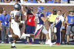 Mississippi quarterback John Rhys Plumlee (10) gives a thumbs-up gesture as he scores a touchdown on a 33-yard run while Vanderbilt safety Brendon Harris (13) trails during the first half of an NCAA college football game in Oxford, Miss., Saturday, Oct. 5, 2019. (AP Photo/Rogelio V. Solis)
