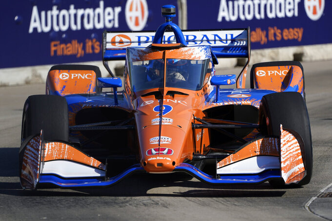 Scott Dixon, of New Zealand, practices for the IndyCar Detroit Grand Prix auto racing doubleheader on Belle Isle in Detroit Friday, June 11, 2021. (AP Photo/Paul Sancya)
