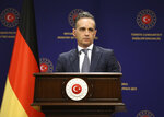 Germany's Foreign Minister Heiko Maas talks during a joint news conference with Turkey's Foreign Minister Mevlut Cavusoglu, following their meeting, in Ankara, Turkey, Monday, Jan. 18, 2021. The ministers met in the Turkish capital, following a tumultuous year in Turkish-European relations, expressing a desire to continue mending ties and solving an ongoing dispute between Turkey and Greece on maritime boundaries and energy rights in the Eastern Mediterranean. (Turkish Foreign Ministry via AP, Pool)
