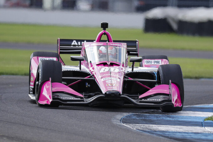 Race driver Jack Harvey, of Great Britain, drives through a turn during qualifying for the IndyCar auto race at Indianapolis Motor Speedway in Indianapolis, Friday, July 3, 2020. (AP Photo/Darron Cummings)